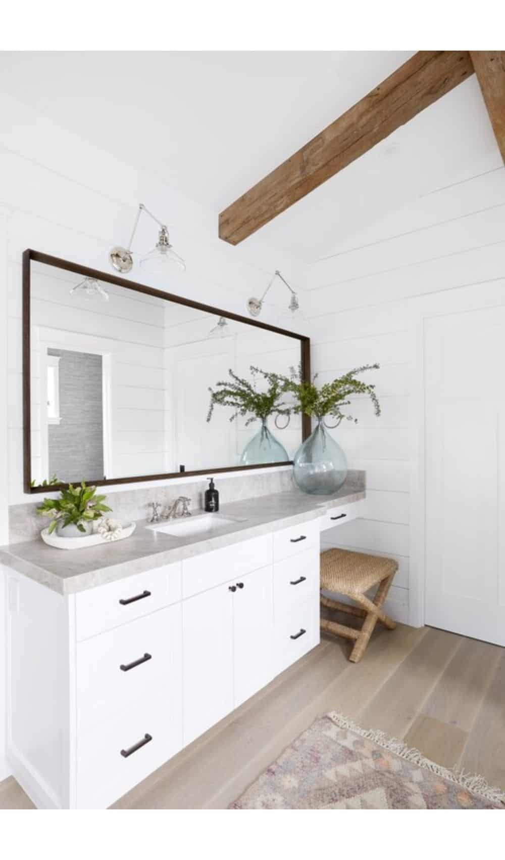 Calm Master Bathroom - Gray and white bathroom vanity with coastal accents