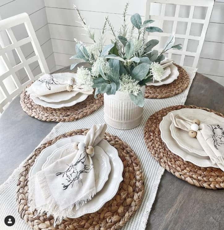 Easter table setting, wicker place mats, neutral bunny napkins