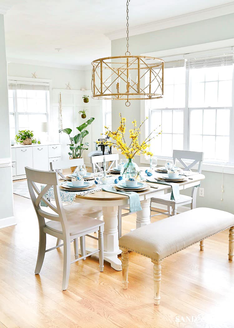 Fun and Vibrant Coastal Spring Table With Yellow Flowers and Aqua Blue