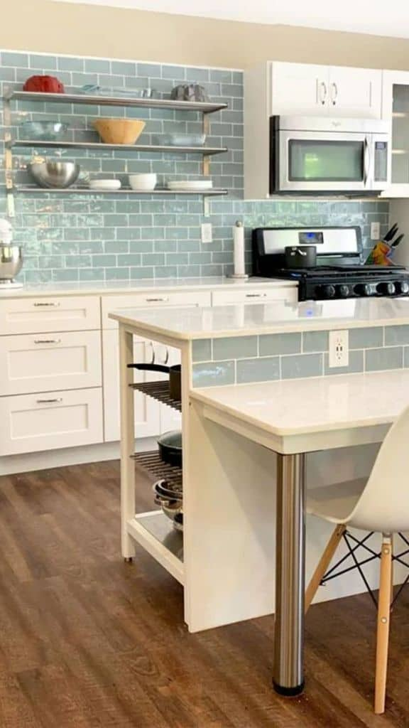 Seafoam Blue Tile Backsplash In White Kitchen