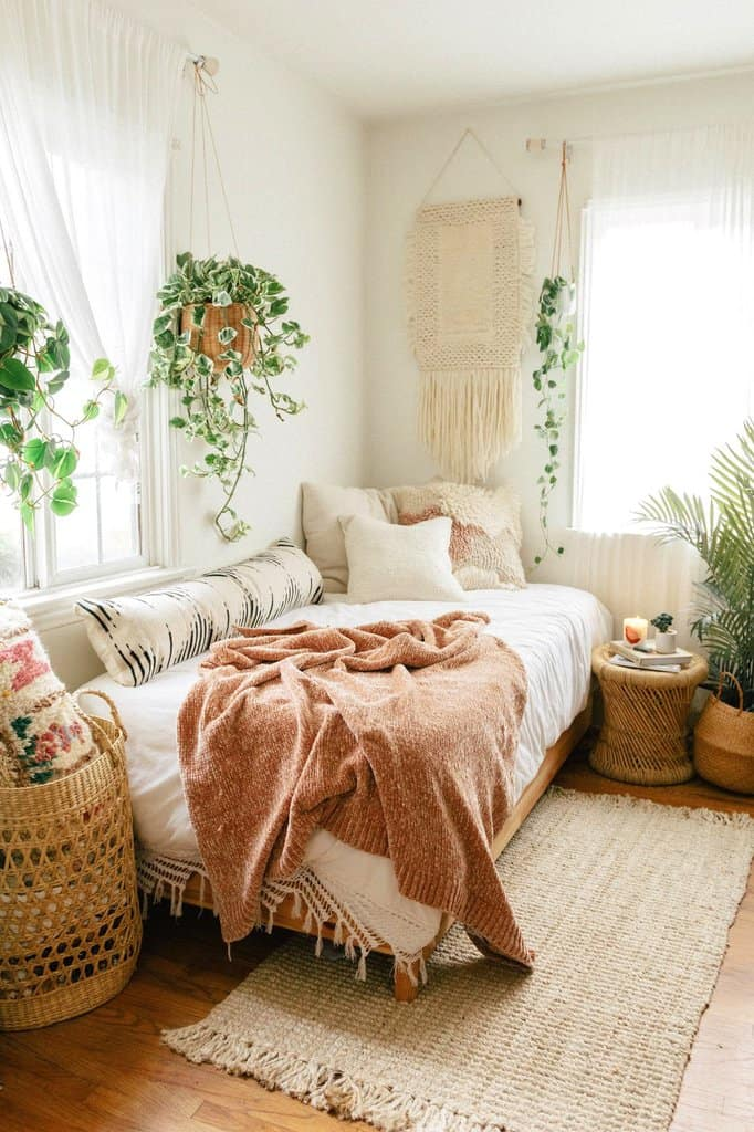 small space boho bedroom with wicker and greenery
