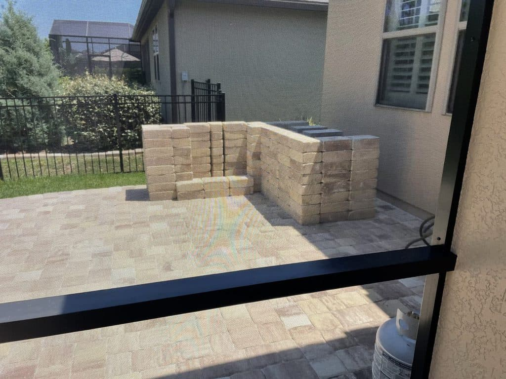 Stacking retaining wall blocks for grill