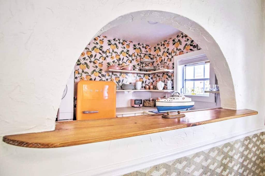 tiny kitchen orange fridge