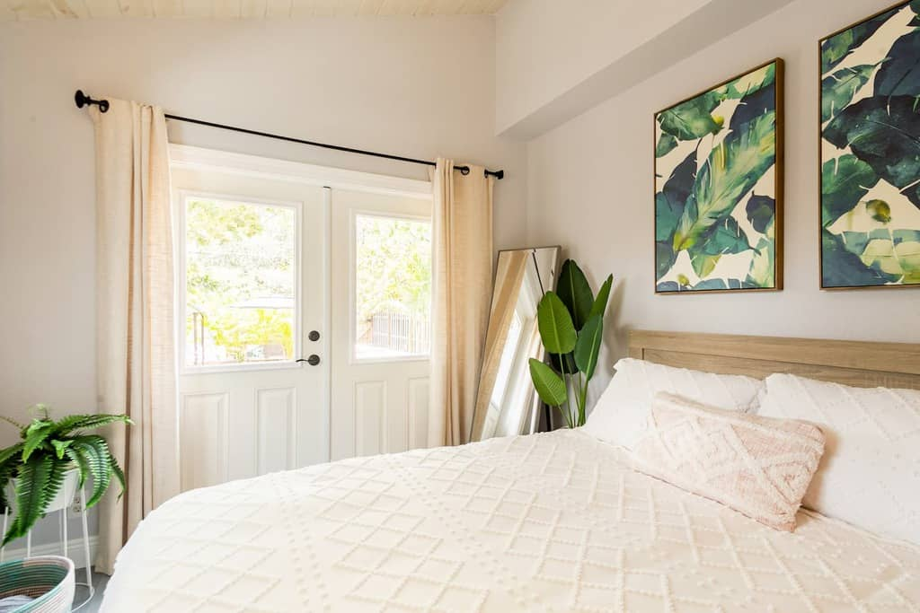 tropical palm vibes bedroom airbnb